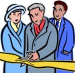 politician cutting ribbon