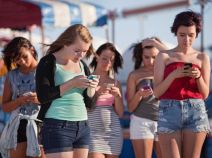 group-of-girls-looking-at-phones